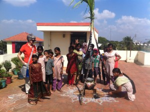 Poomani lighting the fire to cook the rice for Pongal Celebrations at Assisi Illam