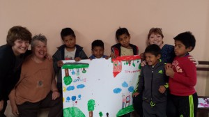 Team #172 with children and their drawings in Alto Progreso