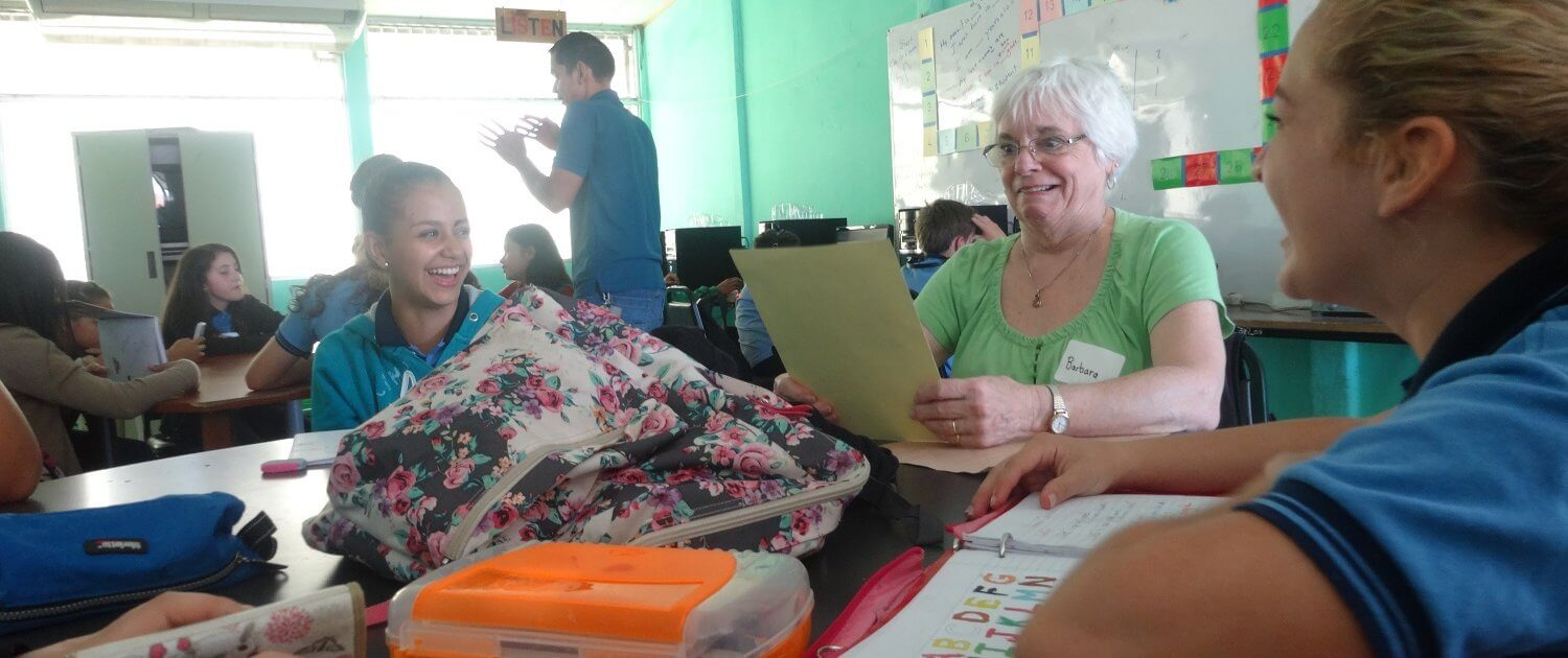 Global Volunteer Barb Chase having fun with her conversational English students in Costa Rica
