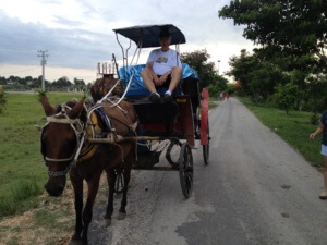 Cuban students escort us to our horse buggies