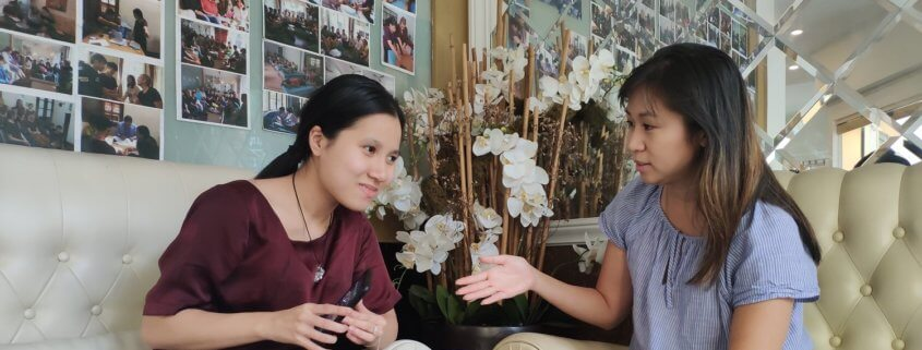 Volunteer converses with visually impaired student in Vietnam