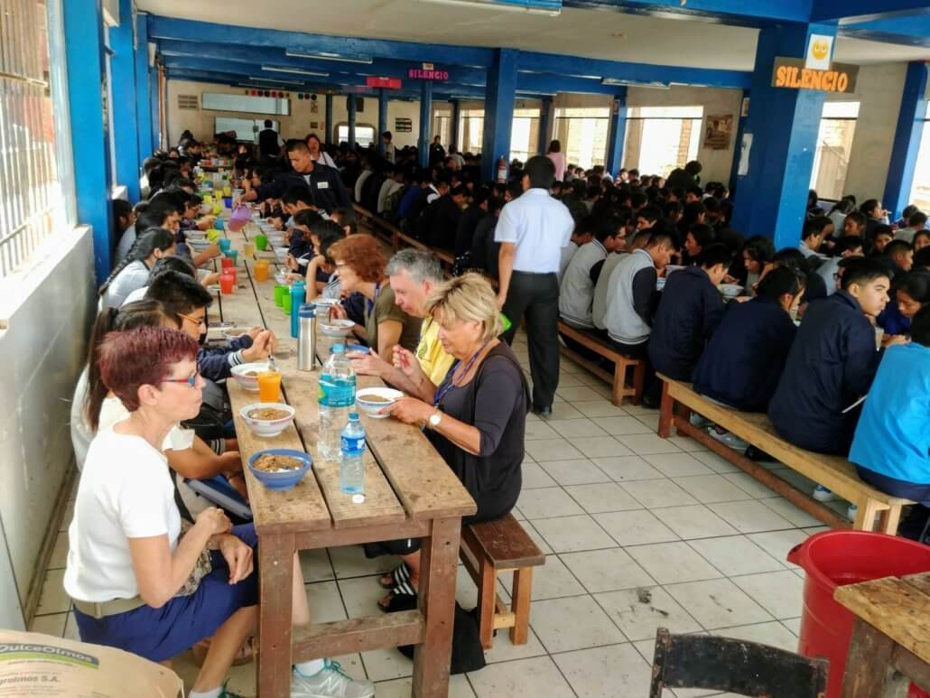 Volunteers share lunch with 1,300 students in peru